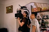 "Gordon Yu (left) and Julian Kim record a scene for the film ""Happy Cleaners,"" which examines the lives of working-class Korean Americans. Photo by Janice Chung."