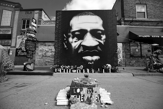 A portrait of George Floyd by artist Peyton Scott Russell forms part of a memorial to Floyd in Minneapolis. Former Minneapolis police officer Derek Chauvin was convicted April 20 for murdering Floyd. Photo by Lorie Shaull.