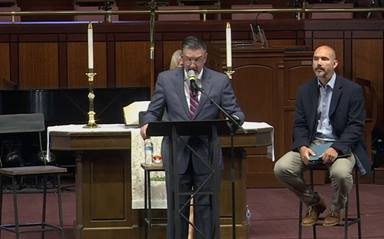 During an April 26 press conference given by Mt. Bethel United Methodist Church, Jody Ray surrenders his clergy credentials in response to being reassigned by Bishop Sue Haupert-Johnson. Church leaders also announced the congregation is beginning the process of disaffiliating from The United Methodist Church. Screenshot of livestream courtesy of Mt. Bethel United Methodist Church.