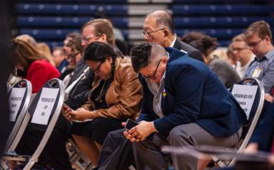 The Rev. Jessica Winderweedle (right) joins in prayer with other members of the Greater New Jersey Way Forward Team during an Oct. 26, 2019 special session of their annual conference at Brookdale Community College in Middletown, N.J. The United Methodist Judicial Council has issued five decisions related to the bishop's rulings of law from that session. File photo by Corbin Payne.