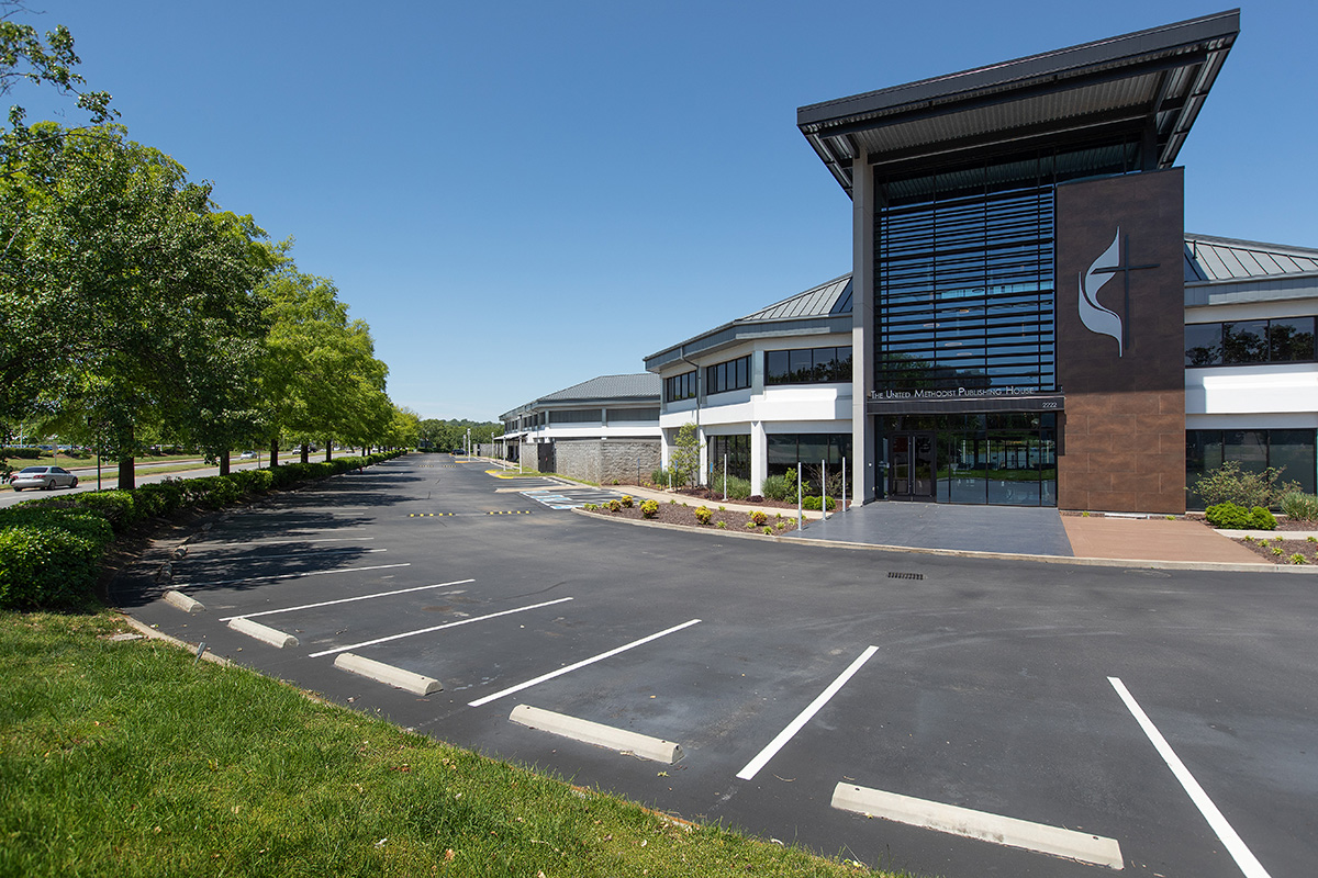 The parking lot of the United Methodist Publishing House in Nashville, Tenn., stands empty on Friday, May 1, 2020. The self-supporting agency recently entered a purchase agreement with an investment firm expected to lease the office space to the public. That move, combined with better sales of church resources as the pandemic lifts in the U.S., has brightened the Publishing House's financial picture. File photo by Mike DuBose, UM News.