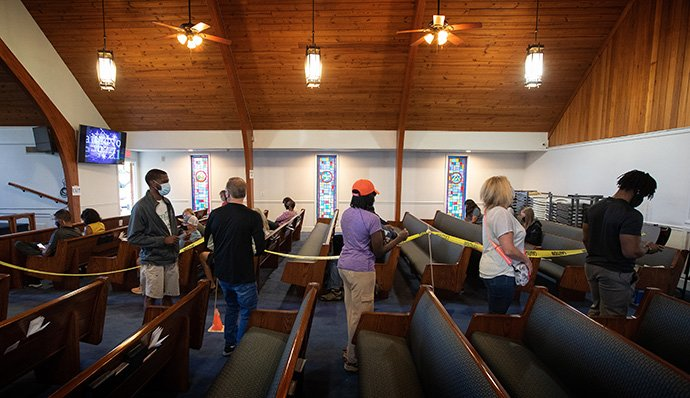 Patients form a line in the church sanctuary as they wait to receive a COVID-19 vaccination at St. Mark's United Methodist Church in Charlotte, N.C. Those who have already received their dose wait in the background while being monitored for any possible side effects. Photo by Mike DuBose, UM News.