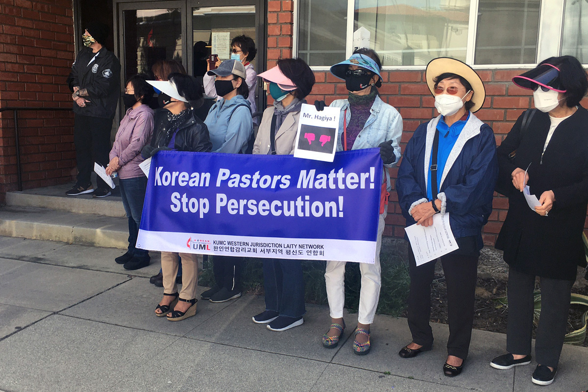 Korean American United Methodists and others stage a demonstration outside the California-Pacific Conference office in Pasadena, Calif., on May 21. The group was protesting Bishop Grant Hagiya's decision to move three Korean American pastors from the churches they've been serving. Photo by Ted Smith III.