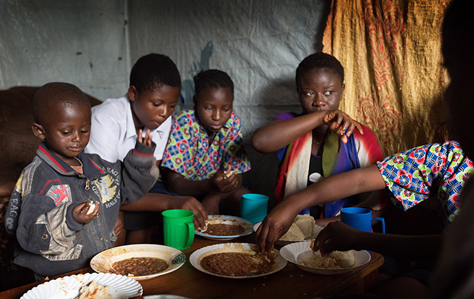 Children share a meal at the United Methodist orphanage in Goma, Congo, in 2015. Current residents of the orphanage were evacuated following the May 22, 2021, eruption of the Mount Nyiragongo volcano. File photo by Mike DuBose, UM News.