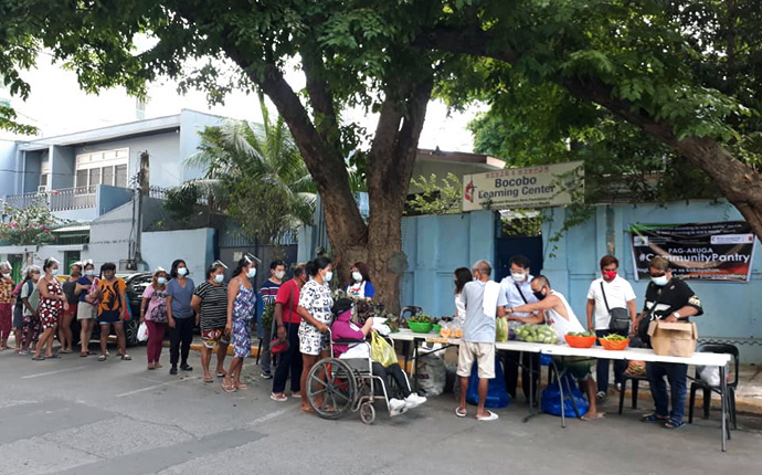 People line up to collect fresh food at a community pantry in Bocobo, Manila, in the Philippines. United Methodists in the region are helping to fight food insecurity during the COVID-19 pandemic. Photo courtesy of Liza Cortez.