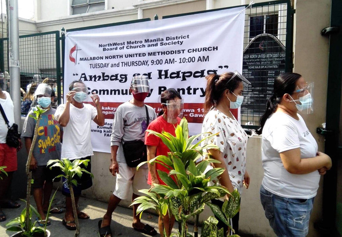 Visitors wait in line at a community pantry led by the NorthWest Metro Manila District Board of Church and Society held outside Malabon North United Methodist Church in Malabon, Philippines. Photo courtesy of the Rev. Charles Jenkin Mendoza.