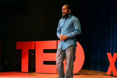 DeAmon Harges delivers a Ted Talk in 2017. Harges, a member of Broadway United Methodist Church in Indianapolis, is one of five winners of the inaugural Tom Locke Innovative Leader Award from the Wesleyan Investive. He is a community organizer who has consulted in South Africa, Canada and Central America. Photo by WildStyle DaProducer.