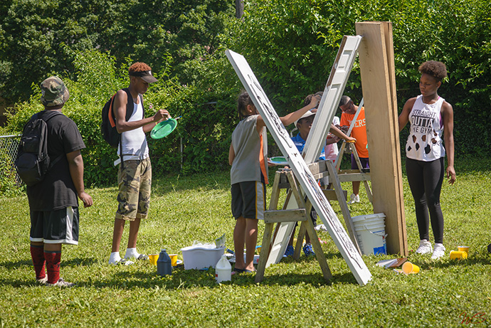 """Indianapolis artists paint doors for use in a 2016 exhibit, """"Perception: What's Behind the Door?"""" The exhibit was an outreach by The Learning Tree, which was founded by DeAmon Harges to use assets within a community to improve neighborhoods. Photo by WildStyle DaProducer."""