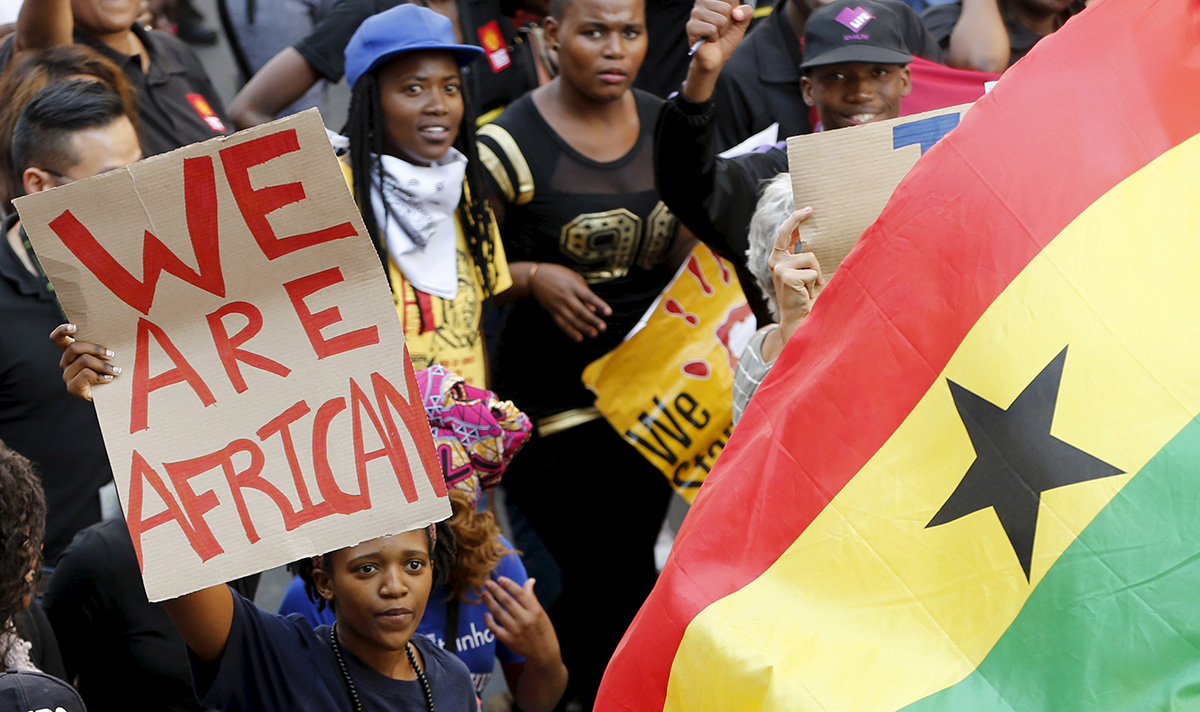 Demonstrators carry placards during a march against xenophobia in Johannesburg in 2015. Xenophobia — fear or hatred of strangers or foreigners — continues to be widespread in South Africa, where harassment and violence against African and Asian non-nationals are routine and sometimes lethal, according to Human Rights Watch. File photo by Mike Hutchings, Reuters.