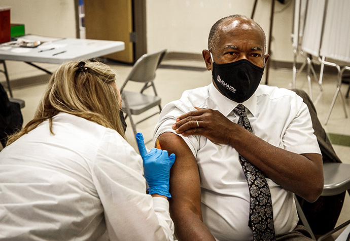 Dr. James Hildreth, president of Meharry Medical College in Nashville, Tenn., receives a COVID-19 vaccination at a city-run clinic in December 2020.  Hildreth said in news reports at the time that he received the vaccine on camera in order to demonstrate his confidence in its safety. Photo courtesy of Meharry Medical College.