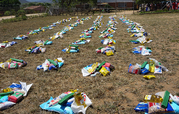 Bundles of food and sanitation supplies are laid out for recipients at the The United Methodist Church's Mutambara Mission, south of Mutare, Zimbabwe. Photo by Kudzai Chingwe, UM News.