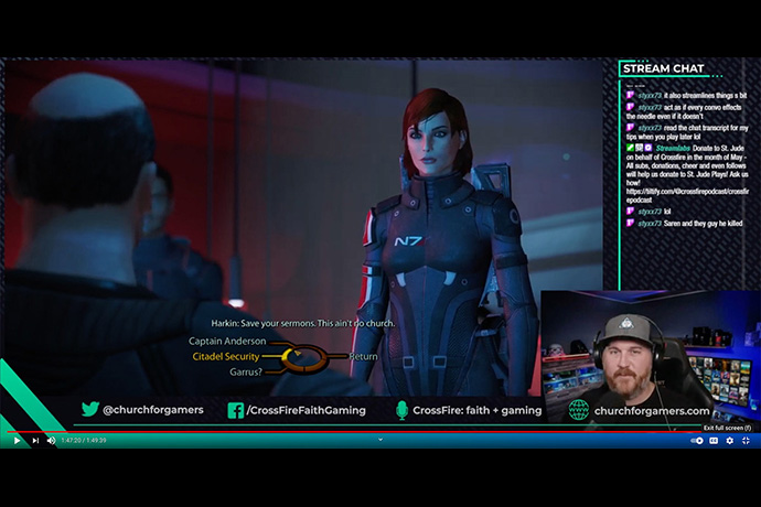 The Rev. David Petty, shown in the inset image at lower right, plays the Mass Effect video game online. Petty, senior pastor at St Paul's United Methodist Church in Colorado Springs, Colo., has been in ministry with the gaming community since 2017. UM News screenshot from YouTube.