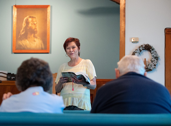 Pastor Laura Vincent reads the Scripture lesson during worship at Oakton United Methodist Church outside Clinton, Ky. Photo by Mike DuBose, UM News.