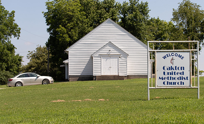 Members arrive for Sunday worship at Oakton United Methodist Church outside Clinton, Ky. Photo by Mike DuBose, UM News.