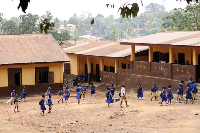 Pupils of the UMC Kulanda Town in Bo, in southern Sierra Leone, rush back to class in March 2020, shortly before schools were closed down after the first cases of COVID-19 were confirmed in the country. There are more than 350 United Methodist schools in Sierra Leone, with the majority of them assisted by the government and affected by the free education initiative. File photo by Phileas Jusu, UM News.