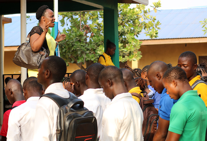 Lauretta Lengor conducts morning devotion at the Njagboima United Methodist Secondary School in Bo, Sierra Leone, in March, 2020, shortly before the first confirmed COVID-19 case was announced in the country. File photo by Phileas Jusu, UM News.