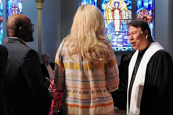 The Rev. Don Lee, senior pastor of First United Methodist Church in Denton, Texas, greets people arriving for a June 6 service. Lee says the church wants to draw on lessons learned during the pandemic, including continuing its online presence. Photo by Sam Hodges, UM News.