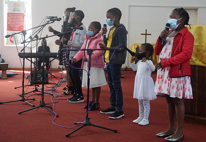 Nashe Chokera (second from right) sings with the Junior Church Sunday praise team at Chisipiti United Methodist Church in Harare. Photo by Kudzai Chingwe, UM News.