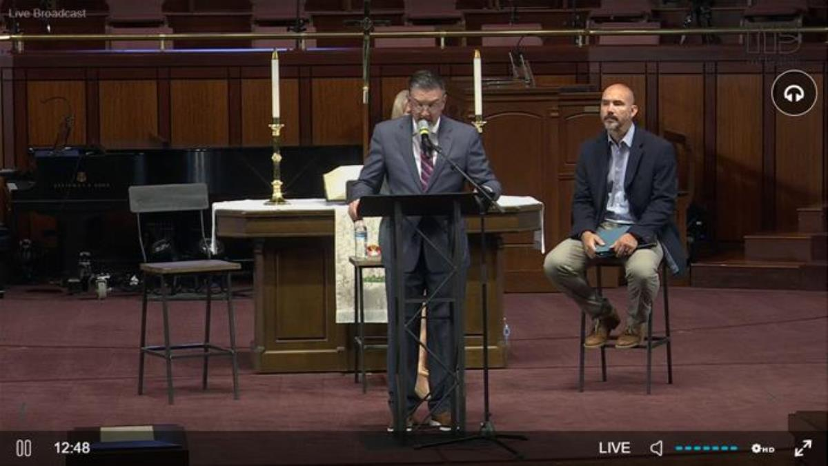 During an April 26 press conference given by Mt. Bethel United Methodist Church, Jody Ray surrenders his clergy credentials in response to being reassigned by Bishop Sue Haupert-Johnson. He remains as the church's lay preacher and chief administrator. Screenshot of livestream by UM News, courtesy of Mt. Bethel United Methodist Church.
