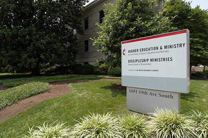 A sign outside the Kern Building shows that it has been home to both Discipleship Ministries and the United Methodist Board of Higher Education and Ministries. The two will continue to share office space in the Harry Denman Building across the street. Photo by Mike DuBose, UM News.
