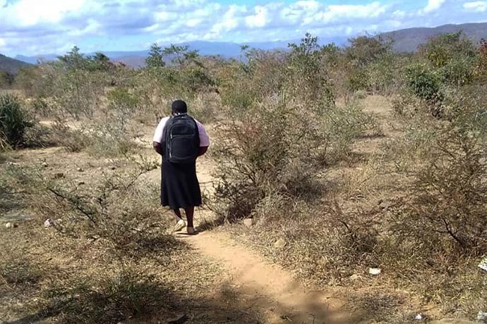 The Rev. Annamore Kahlari walks home from Nemanje United Methodist Church, one of five congregations she serves near Makoni Buhera, Zimbabwe. The church is about 15 miles from her home. Photo by Chenayi Kumuterera, UM News.