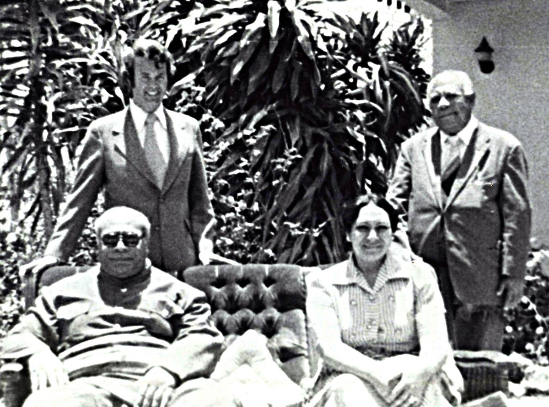 The Rev. H. Eddie Fox (left, rear) poses with King Tāufaʻāhau Tupou IV and Queen Halaevalu Mataʻaho ʻAhomeʻe of Tonga (seated) in 1975. Photo courtesy of the Rev. H. Eddie Fox.