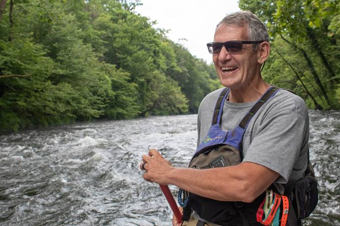 The Rev. Wayne Dickert guides a raft down the Nantahala River near Bryson City, N.C. Dickert. A 1996 U.S. Olympic kayaker and pastor of Bryson City United Methodist Church, Dickert has conducted riverside services beside the Nantahala for the past 15 years. Photo by Mike DuBose, UM News.