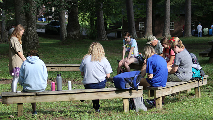 Mission team members hold a morning devotional at the Mountain T.O.P. ministry headquarters in Coalmont, Tenn., before leaving for their work site. Photo by the Rev. Thomas Kim, UM News.
