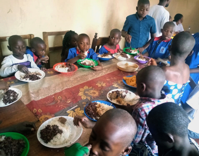 Orphans at United Methodist Goma Orphanage share a meal in the refectory after receiving food provided through donations from United Methodists. The church in Congo is helping some 40 orphans who lost their parents in a May 22 volcanic eruption. Photo by Philippe Kituka Lolonga, UM News.