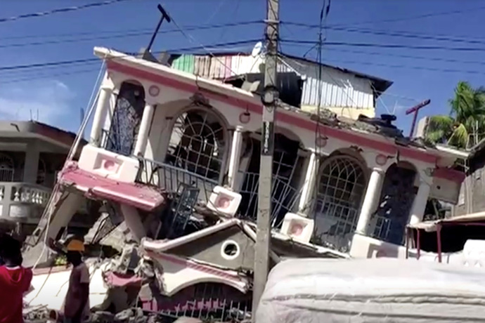 A view of a collapsed building following an earthquake in Les Cayes, Haiti, seen in this still image taken from a video obtained by Reuters on Aug. 14, 2021. United Methodists are working with longtime partners in Haiti to respond after the 7.2-magnitude earthquake and as a major storm approaches. REUTERS TV via REUTERS.