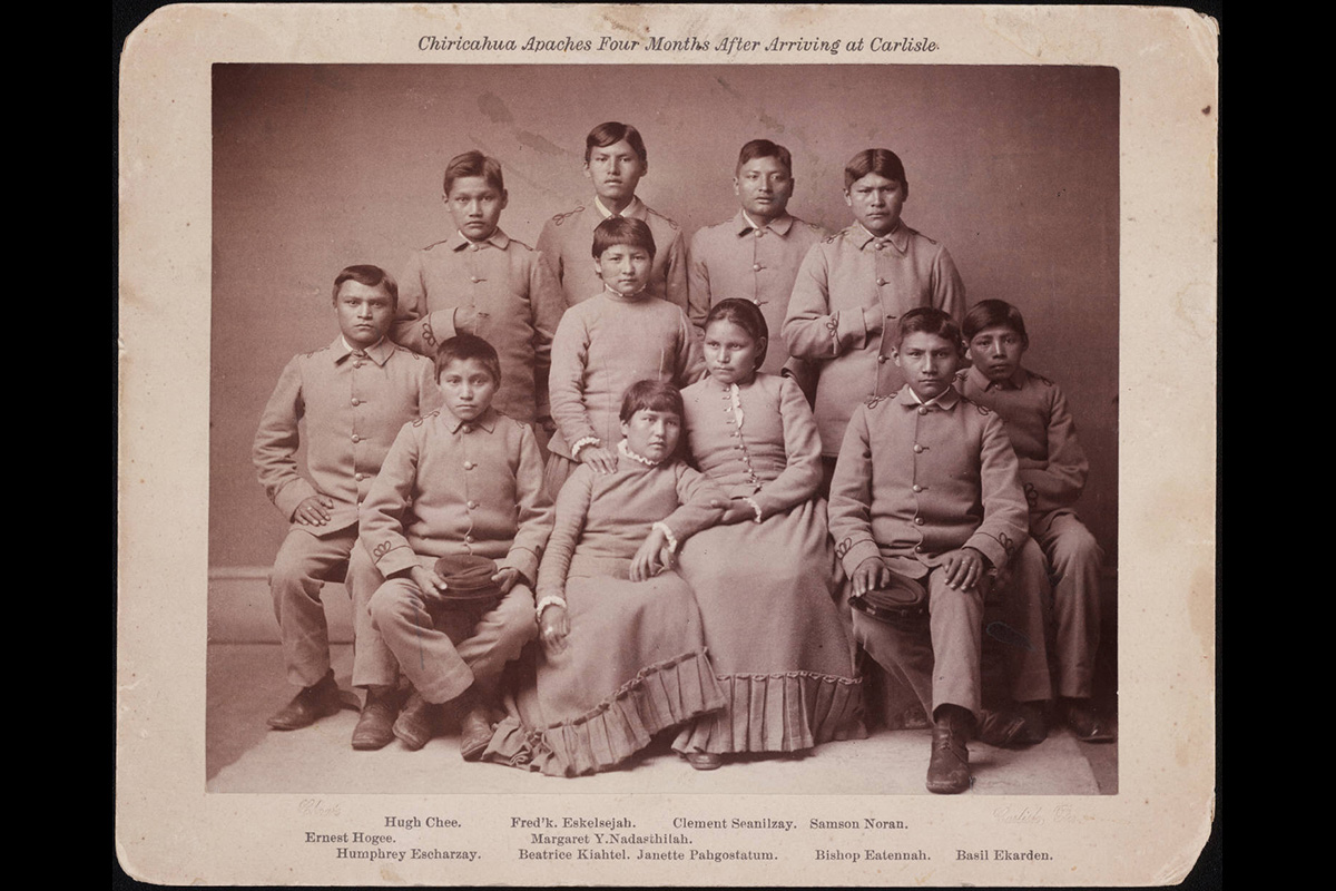 This portrait from 1887 shows people from the Chiricahua band of Apache Native Americans about four months after their arrival at the United States Indian Industrial School in Carlisle, Pa. Native Americans were taken from their homes and enrolled in boarding schools for many years, separating students from both their families and their culture. Image courtesy of the Richard Henry Pratt Papers, Beinecke Rare Book & Manuscript Library, Yale University via Wikimedia Commons.