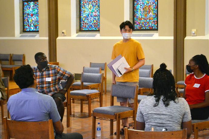 International students of Garrett-Evangelical Theological Seminary join in an orientation discussion on Aug. 23 at the United Methodist school's campus in Evanston, Ill. The fall term marks a return to in-person classes and other in-person gatherings for Garrett, which went online only after the COVID-19 pandemic hit hard in March 2020. Photo by Shane Nichols.