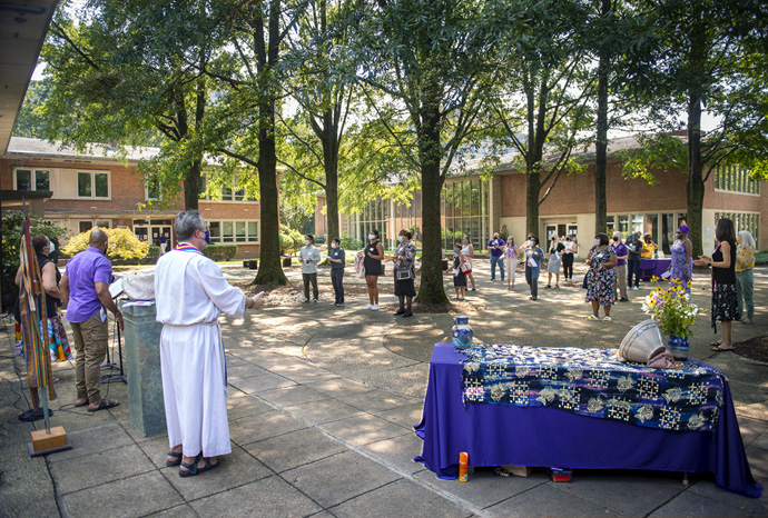 Wesley Theological Seminary holds a Renewal of Baptism and Shell Service on campus in Washington on Aug. 24. The United Methodist school had not held an in-person gathering on campus since the COVID-19 pandemic hit hard in March 2020. The service uses shells as a symbol of students' journey of faith and ministry. Photo by Lisa Helfert Photography for Wesley Theological Seminary, 2021.