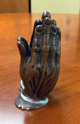 A statue of praying hands was given to Michigan Area Bishop David Alan Bard for a sermon he preached as a Boy Scout. That was his first sermon, and he has kept the statue through the years. Photo courtesy of Bishop David Bard.