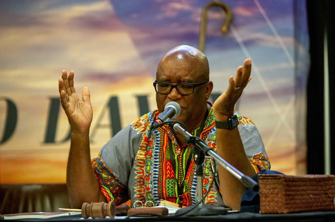 Bishop W. Earl Bledsoe prays during the Northwest Texas Annual Conference session. The bishop and other conference leaders stress that a resolution in favor of the conference leaving The United Methodist Church is aspirational and nonbinding. Photo courtesy of the Northwest Texas Conference.
