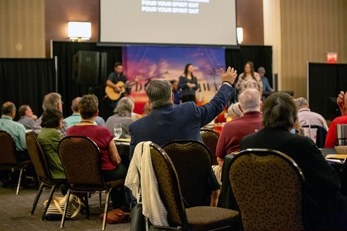 Conference voters join in worship during the Aug. 13-14 Northwest Texas Annual Conference at the Overton Hotel in Lubbock, Texas. During the meeting, the voters overwhelmingly passed an aspirational resolution signaling that the conference would join a new traditional Methodist denomination under a proposed plan of separation. Photo courtesy of the Northwest Texas Conference.