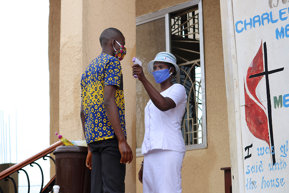 A worshipper's temperature is taken before he is allowed into the worship service July 19, 2020, at Charles Davies United Methodist Church in western Freetown, Sierra Leone. On Aug. 16, a ban on congregational worship was lifted in the country, but churches must adhere to guidelines, including the use of face masks, social distancing and limiting services to 90 minutes. File photo by Phileas Jusu, UM News.