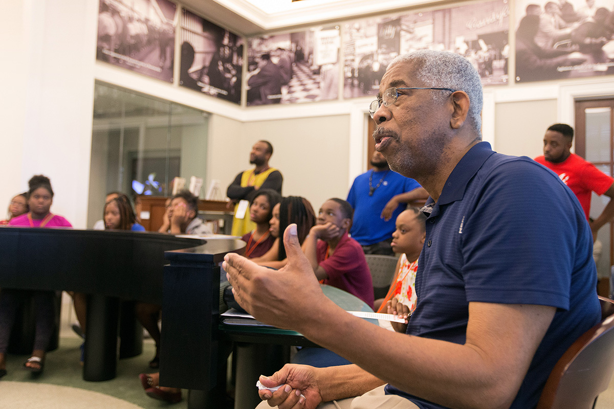 Freedom Rider and civil rights leader Rip Patton visits with students from the Nashville Freedom School Partnership in the Civil Rights Room at the Nashville (Tenn.) Public Library in 2017. Patton helped start Nashville's first Children's Defense Fund Freedom School in 2014. File photo by Mike DuBose, UM News.