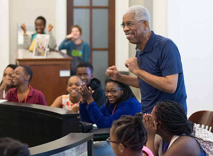 Rip Patton enjoys a cheer from students with the Nashville Freedom School Partnership during a visit to the Civil Rights Room at the Nashville (Tenn.) Public Library in 2017. File photo by Mike DuBose, UM News.