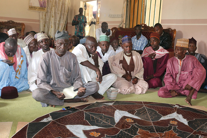 Community leaders in Karim Lamido, Nigeria, gather to discuss peace and reconciliation efforts following episodes of violence in the area. United Methodist Bishop John Wesley Yohanna, who organized the meeting, called on those attending to pray for peace. Photo by Ramson Danjuma, UM News.