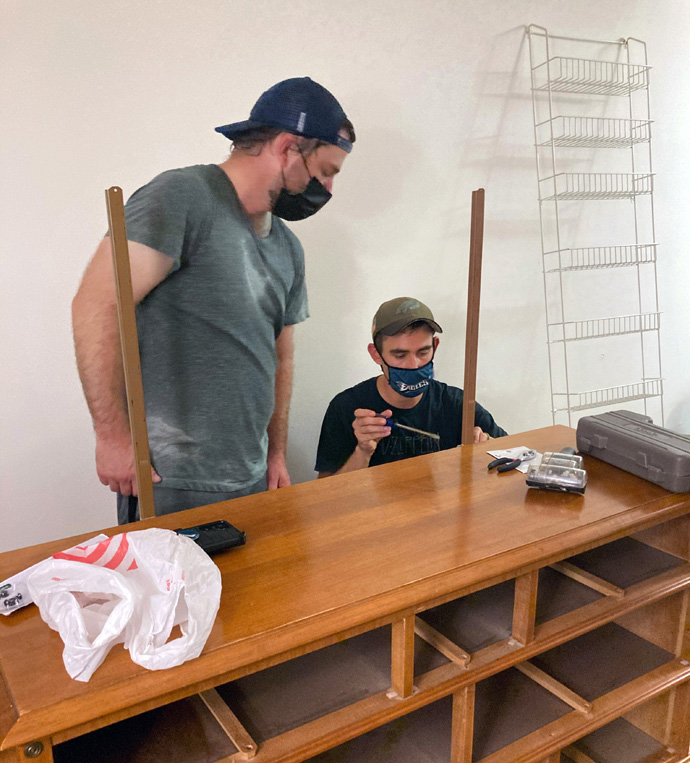 Zach Lenkay (left) and John Densham of Kingstowne Communion, a United Methodist church in Alexandria, Va., assemble furniture for an Afghan refugee family that the church is helping to sponsor. Photo courtesy of Kingstowne Communion.