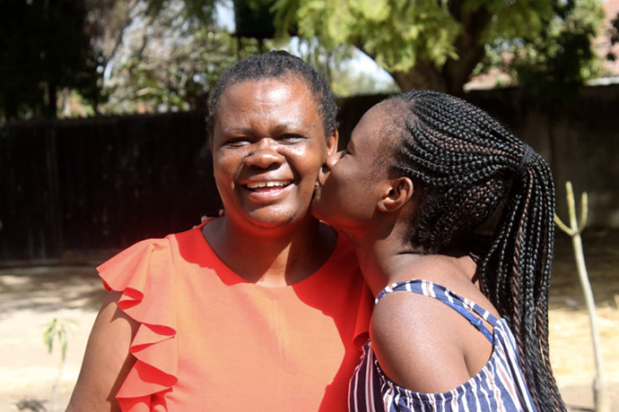 Mellan Nyagato kisses her mother, Jestina, who is recovering from a stroke. Photo courtesy of Mellan Nyagato.