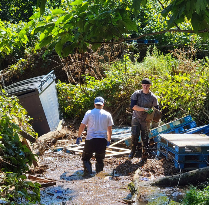 Members of United Methodist Church of Bound Brook, in Bound Brook, N.J., haul out church items that ended up in a nearby creek during Hurricane Ida. Photo courtesy of the Rev. Mcwilliam Colon.