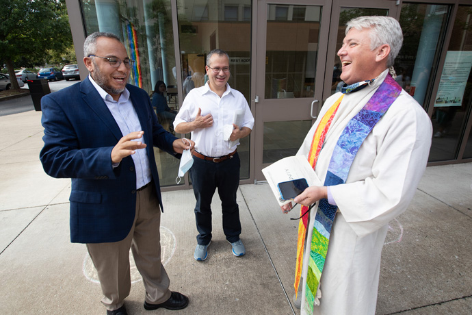 The Rev. Paul Purdue (right) welcomes Imam Ossama Bahloul (left) and board chairman Kamel Daouk from the Islamic Center of Nashville to Belmont United Methodist Church in Nashville, Tenn. The leaders of the nearby mosque came to Belmont on Aug. 29 to express their appreciation to the church for hosting their congregation during Friday prayers in the month of Ramadan. Photo by Mike DuBose, UM News.