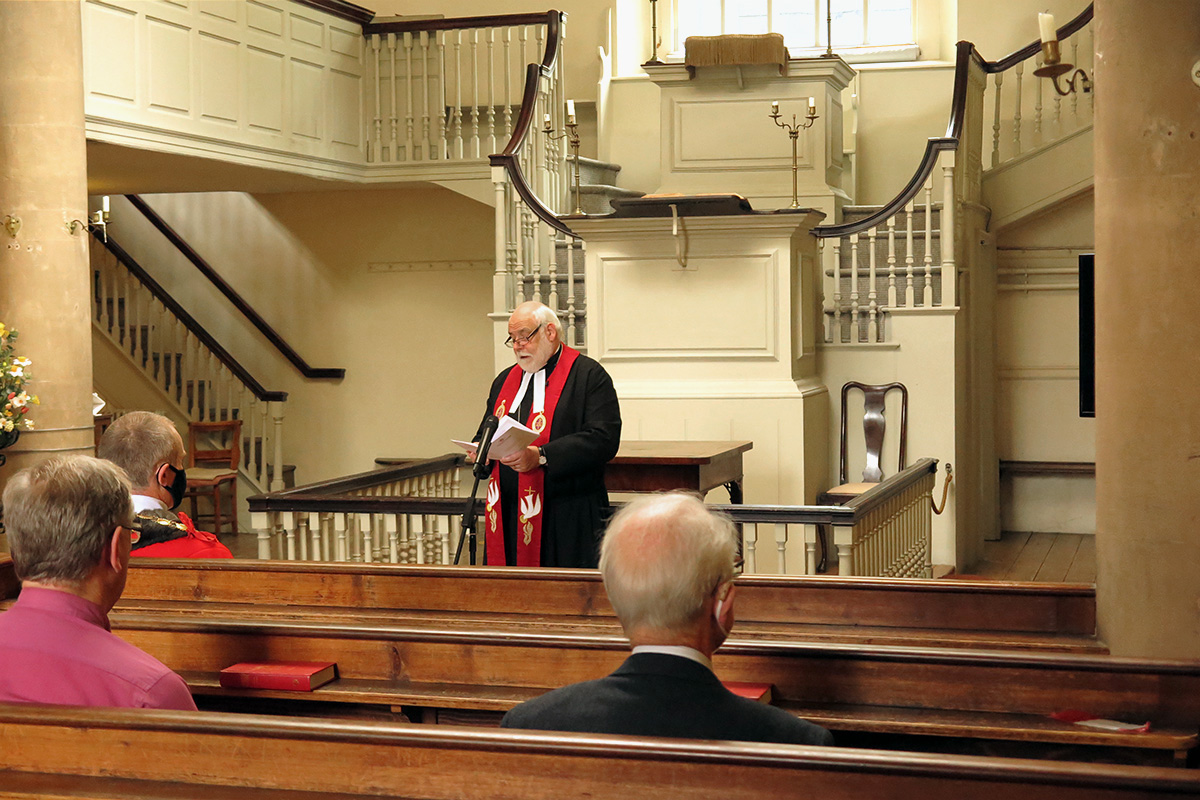 Standing in front of the pulpit of John Wesley's New Room in Bristol, England, the Rev. Jonathan Pye leads a Sept. 12 service celebrating the 250th anniversary of Francis Asbury's crossing of the Atlantic to America. Pye is the chair of the Bristol District of the Methodist Church in Britain and deputy chair of the trustees of John Wesley's New Room. Attendance for the service was limited to allow for social distancing amid the COVID-19 pandemic. Photo by Tim Tanton, UM News.