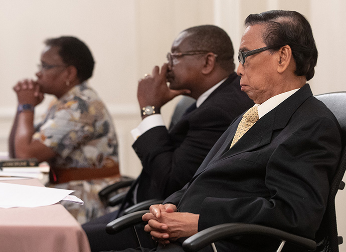Members of the United Methodist Judicial Council listen during an oral hearing at their meeting in Evanston, Ill., in October 2019. From left are: the Rev. J. Kabamba Kiboko, N. Oswald Tweh Sr. and Ruben T. Reyes. Reyes died on Sept. 13. File photo by Mike DuBose, UM News.