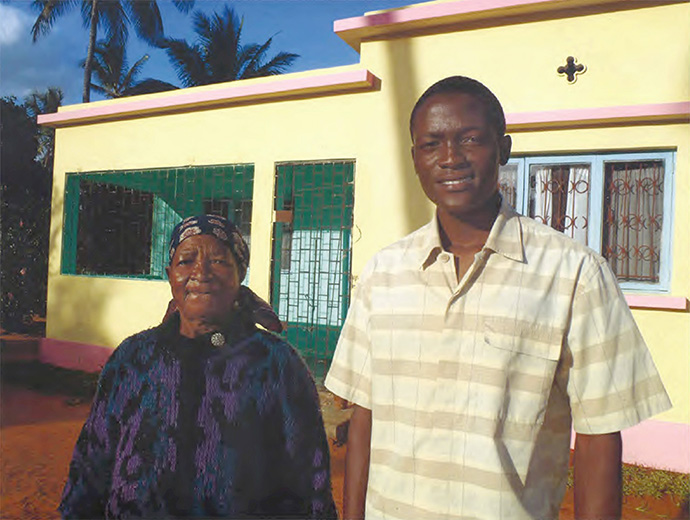 Luisa Chilambe, the spouse of a late clergyman who is collecting a pension from Wespath Benefits and Investments, stands with her pastor the Rev. Vache Benedito in Maputo, Mozambique, in 2003. Photo courtesy of Wespath.
