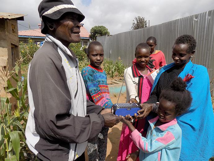 Saloton Ntutu and his family in Narok, Kenya, enjoy listening to Masai songs on Trinity FM. They received the radio as a donation from Trinity United Methodist Church. Photo by Faith Wanjiru, UM News.