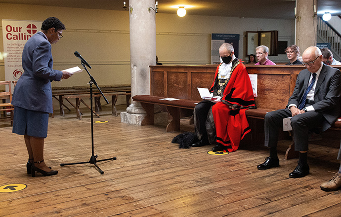 """The Rev. Novette Headley prays with celebrants at the Sept. 12 service celebrating """"The Asbury Crossing: Responding to Call."""" Headley is superintendent minister of the Bristol & South Gloucestershire Methodist Circuit and a trustee of John Wesley's New Room in Bristol, England, where the event was held. Photo by Tim Tanton, UM News."""