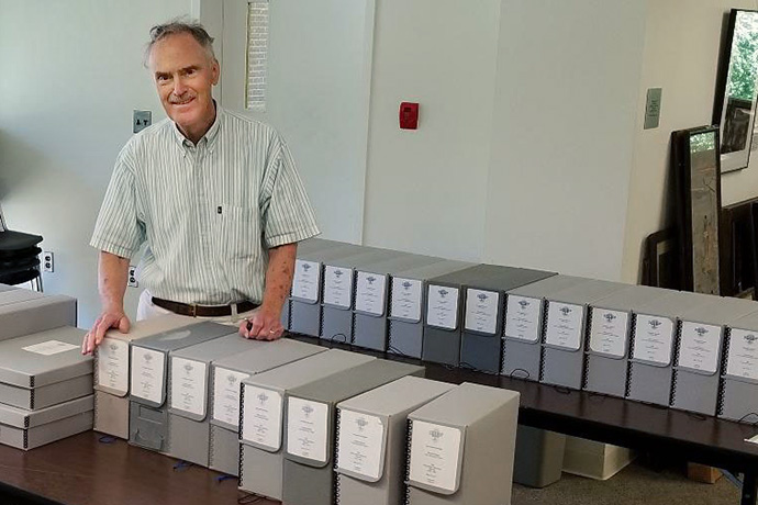 The Rev. Kenneth Rowe, shown here in the United Methodist archives at Drew University in Madison, N.J., was an author, professor, librarian, archivist and bibliographer. Rowe died Oct. 8, at age 84. File photo courtesy of the United Methodist Commission on Archives and History.